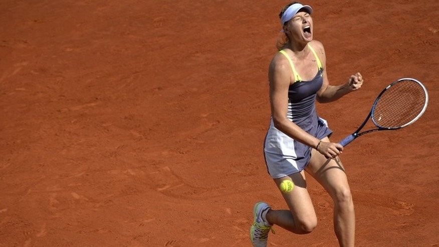 Russia's Maria Sharapova celebrates after a point at the Roland Garros stadium in Paris on June 6, 2013. Tennis stars dominated the list of the world's 10 best-paid female athletes, Forbes magazine said on Tuesday, but highlighted the yawning earnings gap with their male counterparts in most sports.