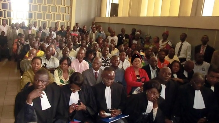 Lawyers wait in a Brazzaville court on August 6, 2013, for the opening of the Congolese soldiers' trial. The group of soldiers went on trial Tuesday over a horrific blast at a munitions dump in Brazzaville last year that left almost 300 people dead.