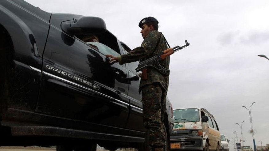 A Yemeni soldier searches a car at a checkpoint on a street leading to the US embassy compound in Sanaa, on August 4, 2013. Security measures were particularly strict in the Yemeni capital after Washington held urgent talks on an Al-Qaeda threat that prompted two dozen embassies and consulates to temporarily halt their services in many capitals in the region.