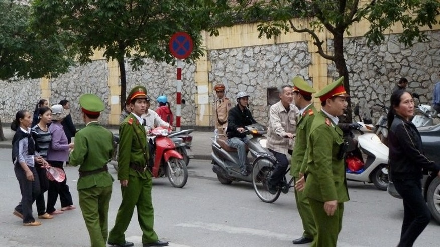 Policemen patrol on a street in Hanoi on April 4, 2011. Vietnam executed its first prisoner by lethal injection on Tuesday, state media said, after a two-year hiatus in carrying out capital punishments due to problems procuring the chemicals.