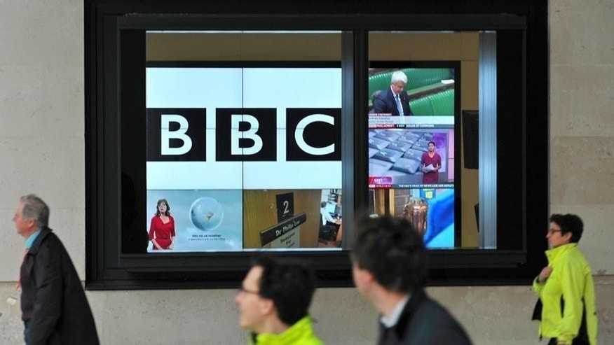 A BBC logo is pictured on a television screen inside the BBC's New Broadcasting House office in central London, on November 12, 2012. Female former newsreader Charlotte Green was on Tuesday appointed by the British Broadcasting Corporation (BBC) as the reader of the classified football results on BBC Radio 5 Live.