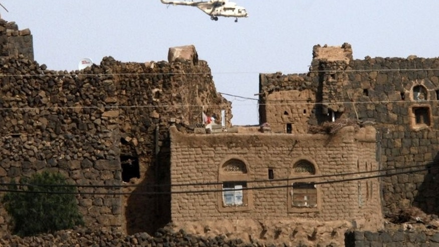A Yemeni army helicopter flies over the district of Arhab in Sanaa province in December 2009.Yemeni tribesmen shot down an army helicopter killing eight soldiers, on Tuesday, during a clash over repairs to a main oil pipeline blown up by saboteurs, a tribal chief said.