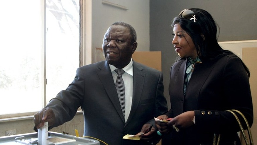 Morgan Tsvangirai and his wife Elizabeth, cast their ballots at a polling station in Harare. Tsvangirai was crushed in last week's vote, with only 34 percent to 61 for Robert Mugabe, still undefeated since he guided Zimbabwe to independence in 1980.