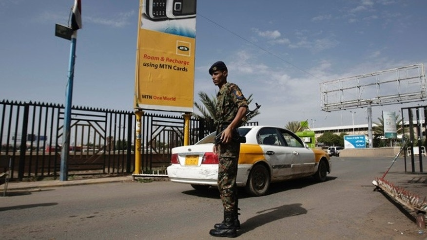 Aug. 7, 2013: A policeman stands guard at the entrance of Sanaa International Airport, Yemen.