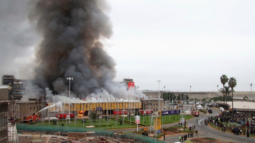 Aug. 7, 2013: Members of the public stand in front of the Jomo Kenyatta International Airport as it goes up in flames in Kenya's capital Nairobi.