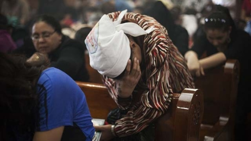 August 6, 2013: An Egyptian Coptic Christian woman prays in a church within Al-Mahraq Monastery in Assiut, Upper Egypt.