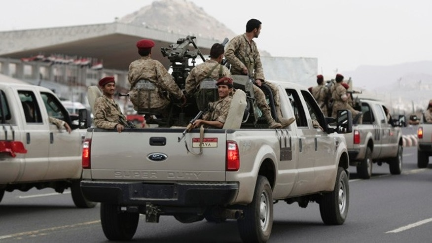 Aug. 2, 2013: Armored vehicles patrol around the presidential palace as Republican Guard troops, loyal to Yemen's ousted President Ali Abdullah Saleh, take part in a demonstration demanding their reward in Sanaa, Yemen.