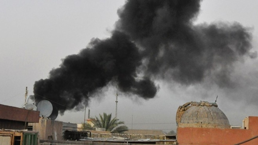 Aug 10, 2013: Black smoke from a car bomb attack is seen in Baghdad, Iraq. A wave of car bombings targeted cafes and markets around the Iraqi capital of Baghdad as people celebrate the end of the Muslim holy month of Ramadan, killing and wounding scores of people, officials said.