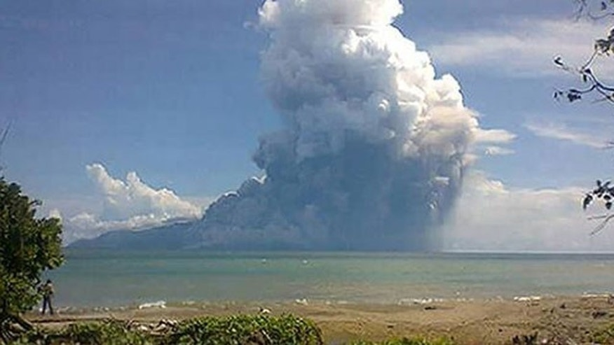 Aug. 10, 2013: The Mount Rokatenda volcano spews a huge column of hot ash during an eruption.
