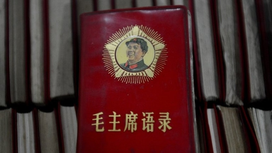 This photo taken on September 25, 2012 shows 'Little Red Books' containing the thoughts of leader Mao Zedong at a Cultural Revolution museum near Chengdu, in Sichuan province. As a teenager radicalised by China's Cultural Revolution, Zhang Hongbing denounced his mother to the authorities. Two months later a firing squad shot her dead.