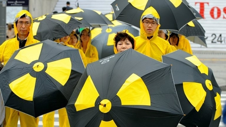 South Korean environmental activists during a demonstration to oppose nuclear power in Seoul on April 6, 2011. South Korea ordered sweltering government offices to turn off their air conditioning as two power plants stopped operations Monday, a day after a minister warned of an imminent national energy crisis.