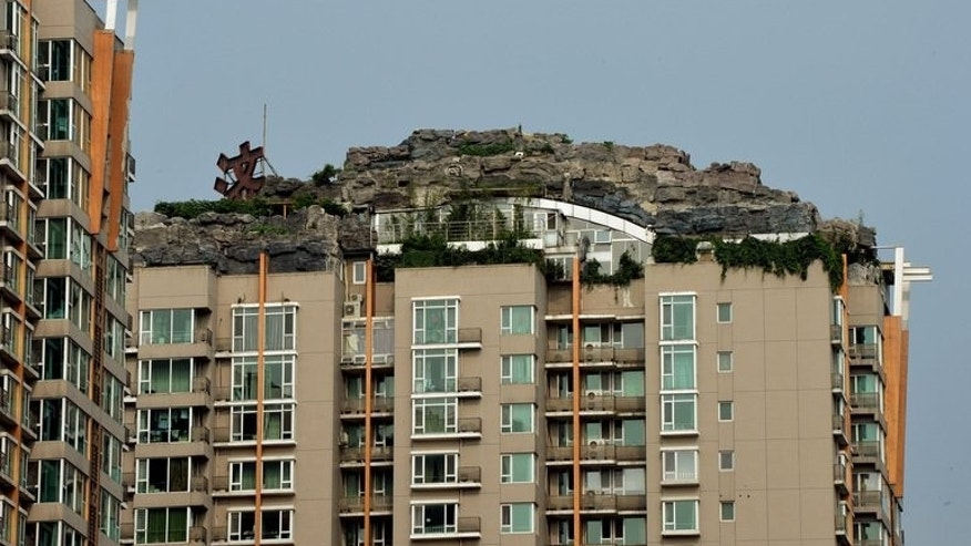 A rooftop apartment surrounded by imitation rocks in Beijing on August 11, 2013. Neighbours have complained about China's latest architectural oddity, which covers more than 1,000 square metres (10,000 square feet), saying they fear it could cause the structure to collapse on top of them, the Beijing Morning Post reported.