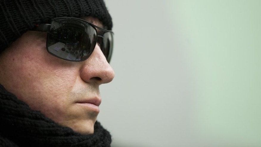 Sergei Filin, the Bolshoi ballet's chief, wears sunglasses and a cap as he sits in the University Hospital of Aachen on March 15, 2013 in Aachen, western Germany. Filin, battling for his eyesight after an acid attack in January, has left his clinic in Germany to visit London for the company's tour, a report said Monday.