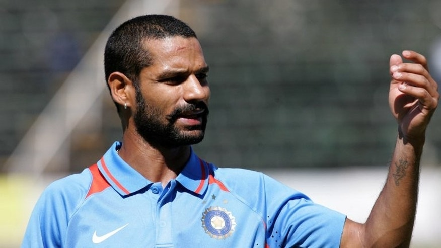 Indian batsman Shikhar Dhawan gestures for drinks during a one-day inernational against Zimbabwe at the Harare Sports Club, on July 26, 2013. Dhawan has struck 248 runs as India A made 433-3 to win a 50-over match against South Africa A.