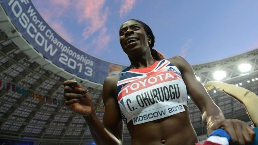 Britain's Christine Ohuruogu celebrates after winning the women's 400 metres final at the 2013 IAAF World Championships at the Luzhniki stadium in Moscow on August 12, 2013.