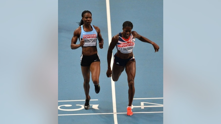 Britain's Christine Ohuruogu (R) wins the women's 400 metres final at the 2013 IAAF World Championships at the Luzhniki stadium in Moscow on August 12, 2013.