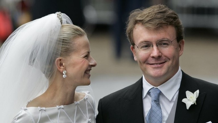 Dutch prince Johan Friso (right) and Mabel Wisse Smit smile during their wedding in Delft, on April 24, 2004. Dutch prince Johan Friso, who died on Monday 18 months after a skiing accident left him brain-damaged, was always regarded as an outsider who preferred to follow his own path rather than royal protocol.