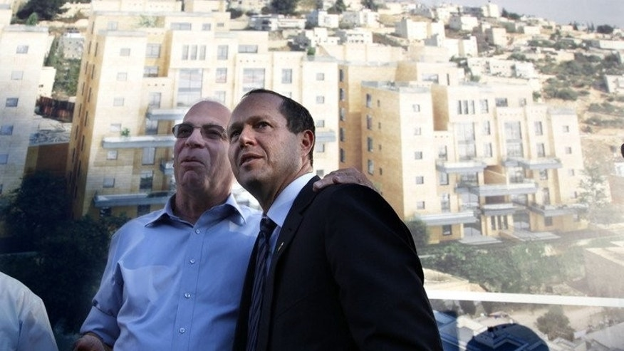 Israeli Housing Minister Uri Ariel (left), of the far-right Jewish Home party, and Jerusalem Mayor Nir Barkat attend a promotion event for new housing units in a Jewish neighbourhood in annexed east Jerusalem on August 11, 2013. The EU on Monday urged Israelis and Palestinians to avoid any actions that could undermine the resumption of peace talks after a three-year negotiating impasse.