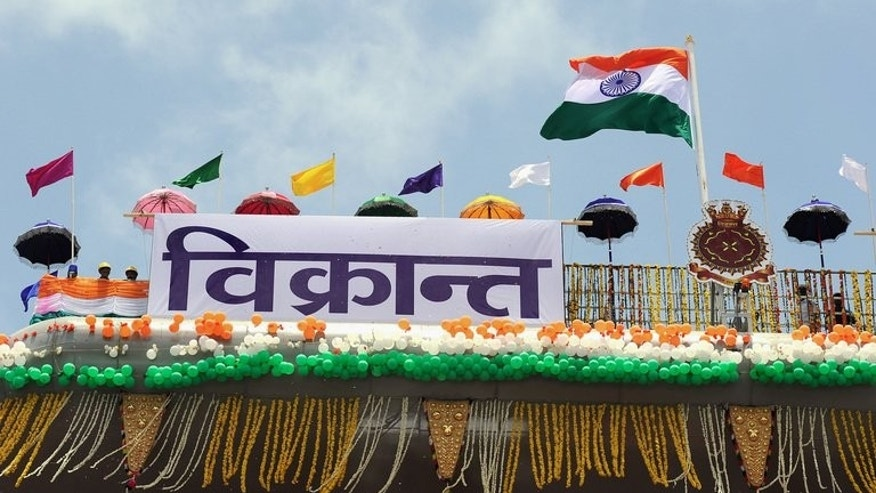The Indian tri-colour flag flutters on the aircraft carrier INS Vikrant during its launch at the Cochin Shipyard in Kochi on August 12, 2013. India launched its first indigenously-built aircraft carrier on Monday, a landmark moment in the $5 billion project that seeks to project the country's power and check the rising influence of China.