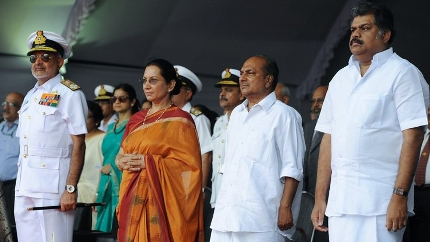 Indian Defence Minister A.K. Anthony (second right), his wife Elizabeth Antony (second left), union minister for shipping G. K. Vasan (right) and chief of naval staff, Admiral D.K. Joshi at the launch of the indigenously-built aircraft carrier INS Vikrant at the Cochin Shipyard in Kochi on August 12, 2013.