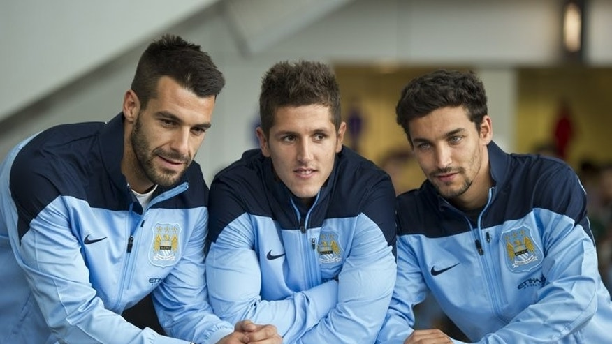 English Premier League football team Manchester City new signings (L-R) Alvaro Negredo, Stevan Jovetic and Jesus Navas in Hong Kong on July 22, 2013. New manager Manuel Pellegrini was given the green light to go on a spending spree.