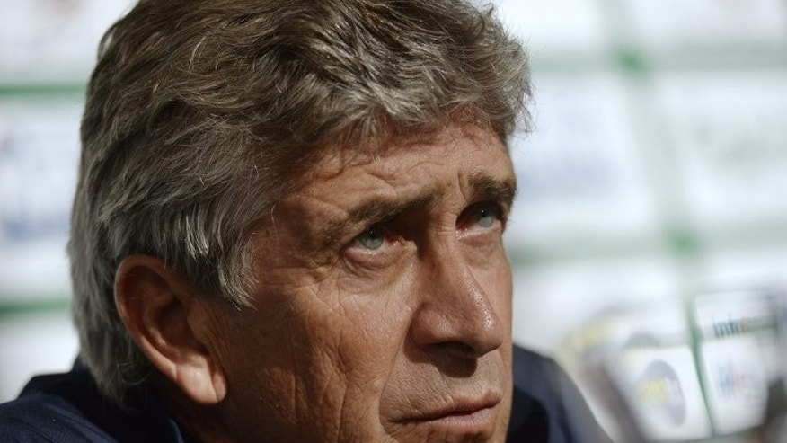 Manchester City's Chilean head coach Manuel Pellegrini at a press conference in Helsinki on August 9, 2013. Pellegrini spent $46 million on his most expensive signing, Brazil's Shakhtar Donetsk.