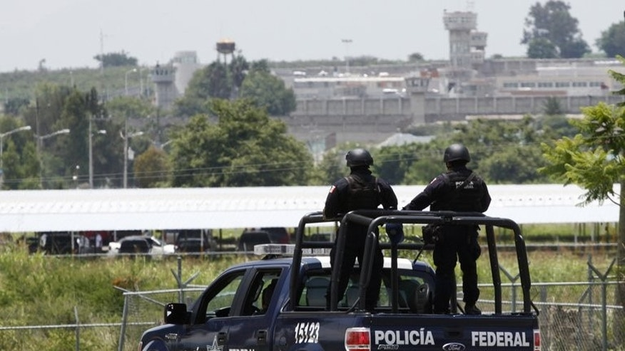 The Mexican Federal Police patrols the surroundings of the Puente Grande State prison in Zapotlanejo on August 9, 2013. The surprise release of Rafael Caro Quintero, a Mexican drug lord jailed for killing a US agent, has angered Washington and increased concerns about Mexico's judicial system.