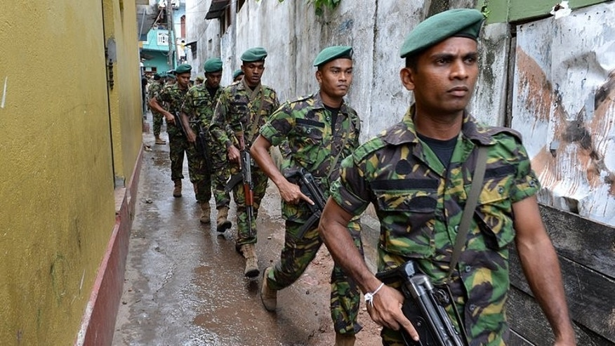 Sri Lankan para-military commandos patrol outside a vandalised mosque in the Sri Lankan capital Colombo on August 11, 2013. Muslim leaders closed the mosque after it was attacked by Buddhists objecting to the new building.