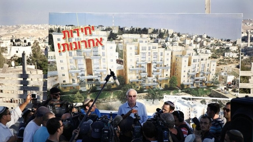 Israeli Housing Minister Uri Ariel speaks to the press during a promotion event for new housing units in the Jewish neighborhood of Armon Hanatsiv in annexed east Jerusalem on August 11, 2013. Israel announced it will release 26 veteran Palestinian prisoners ahead of a resumption of peace talks on Wednesday, but at the same time angered the Palestinians by approving new settlement construction.
