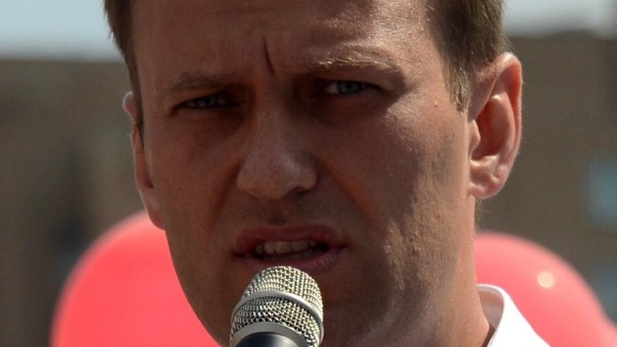 Russian opposition leader Alexey Navalny, delivers a speech during a campaign meeting in Moscow on August 8, 2013. Russian prosecutors on Monday accused protest leader Alexei Navalny of breaking the law by receiving donations from abroad for his campaign as Moscow mayor.
