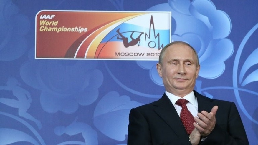 Russian President Vladimir Putin claps during the opening ceremony of the 2013 IAAF World Championships at the Luzhniki stadium in Moscow on August 10, 2013. Russian prosecutors on Monday accused protest leader Alexei Navalny of breaking the law in his campaign for Moscow mayor by receiving donations from foreign nationals, adding to the legal woes of President Vladimir Putin's top critic.