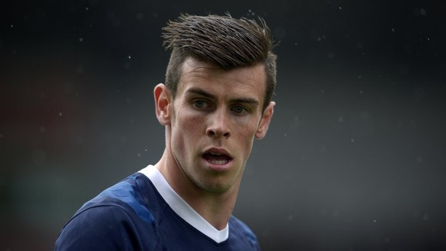 Tottenham Hotspur's Welsh midfielder Gareth Bale plays at the Britannia Stadium in Stoke on Trent, central England, on May 12, 2013. Bale has been ruled out of Wales' friendly against the Republic of Ireland on Wednesday.