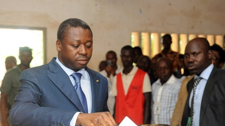 President Faure Gnassingbe casts his vote in Lome on July 25, 2013. Togo's constitutional court on Monday validated results from last month's parliamentary polls giving the ruling party a two-thirds majority and allowing President Faure Gnassingbe's family to maintain its decades-long grip on power.