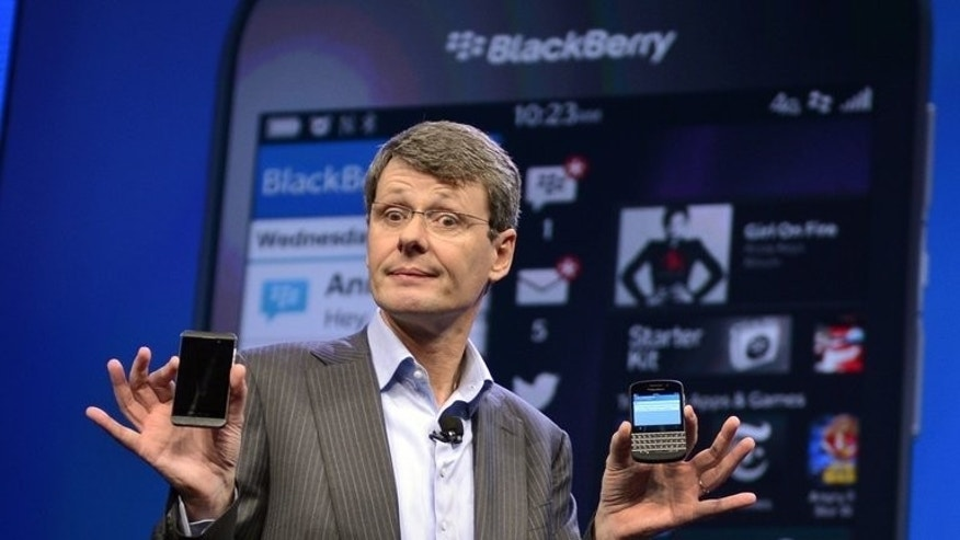 "Blackberry chief executive Thorsten Heins unveils the new 10 mobile platform in New York, on January 30, 2013. The struggling smartphone maker says it is examining ""strategic alternatives,"" including the possibility of selling off the firm."
