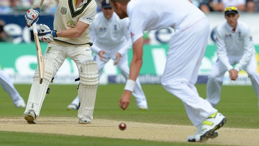 Australia's Chris Rogers (left) plays a shot past England's Stuart Broad (2nd right) during the fourth Ashes Test match at the Riverside stadium in Chester-le-Street, north-east England, on August 12, 2013.