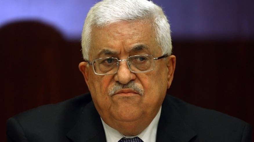 Palestinian president Mahmud Abbas chairs a meeting of the Palestine Liberation Organization (PLO) in the West Bank city of Ramallah, on July 26, 2011. Abbas has asked caretaker prime minister Rami Hamdallah to stay on, tasking him with forming a new government.