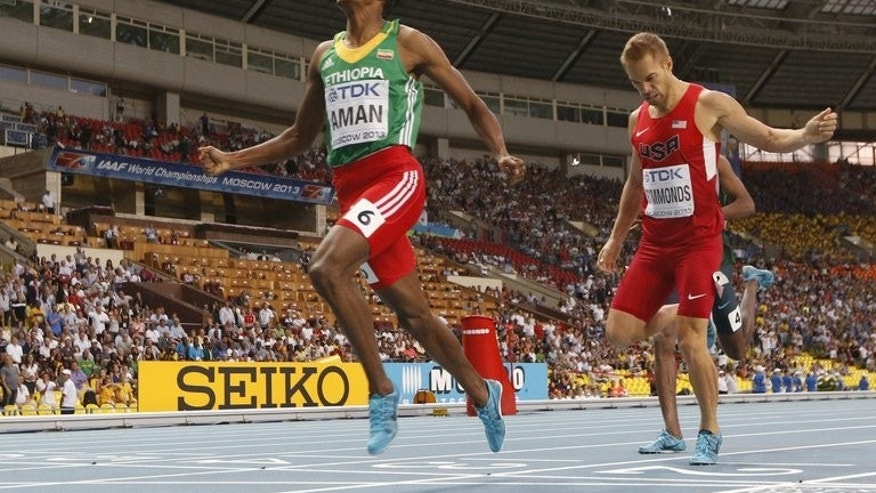 Ethiopia's Mohammed Aman (L) wins the men's 800 metres final at the 2013 IAAF World Championships at the Luzhniki stadium in Moscow on August 13, 2013.