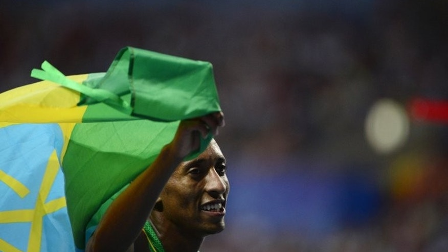 Ethiopia's Mohammed Aman celebrates after winning the men's 800 metres final at the 2013 IAAF World Championships at the Luzhniki stadium in Moscow on August 13, 2013.