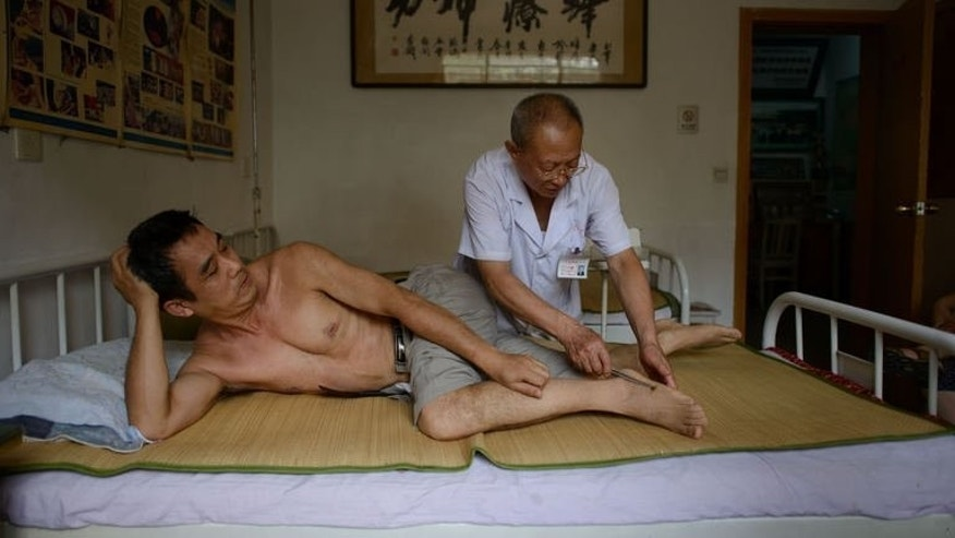 A patient receives a bee sting administered by a doctor of traditional Chinese medicine on August 2, 2013. There is no orthodox evidence that bee stings can cure any illnesses, and some websites in the West have branded their use 'quackery'.