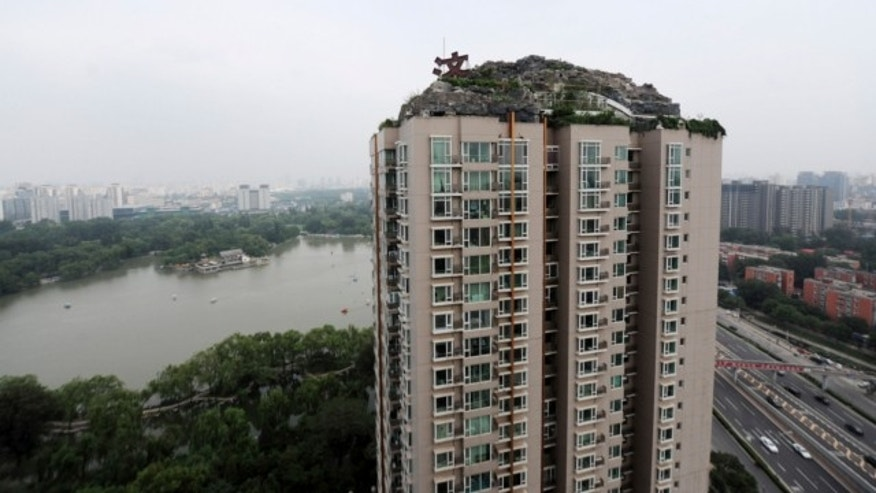 Aug. 12, 2013: This photo released by China's Xinhua News Agency shows a residential building with a rocky style villa on its roof, in Haidian District of Beijing, China.