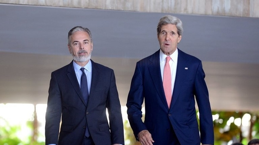 US Secretary of State John Kerry (R) and Brazilian Foreing Minister Antonio Patriota are seen during a meeting at Itamary Palace in Brasilia on August 13, 2013. Brazil warned Kerry on Tuesday that failure to resolve the row over Washington's electronic spying could sow mistrust between the countries.