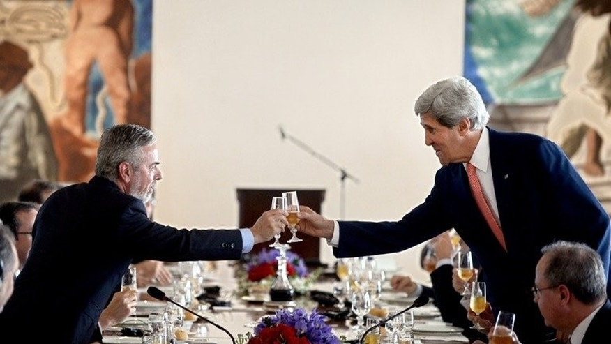 US Secretary of State John Kerry (R) and Brazilian Foreign Minister Antonio Patriota toast before a luncheon at Itamary Palace in Brasilia on August 13, 2013. Washington has argued that it needs the vast surveillance program conducted by the National Security Agency to combat terrorism.