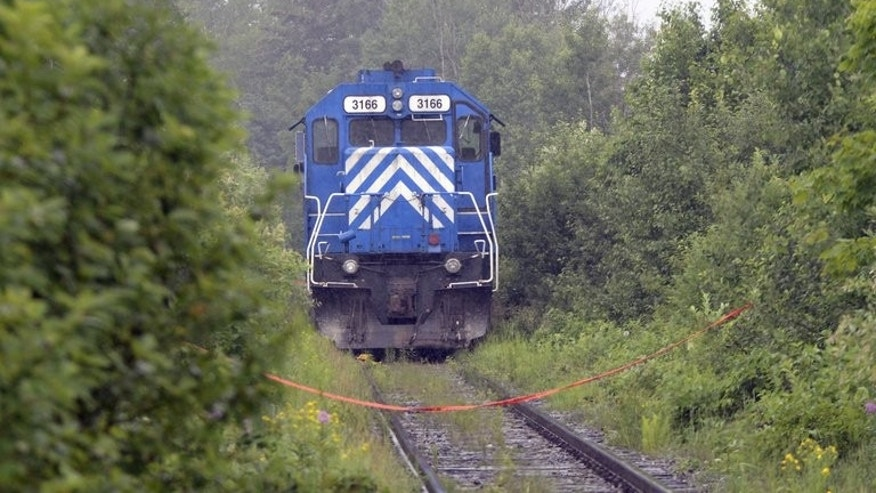 A train from the MMA (Montreal, Maine and Atlantic) railway is viewed as it was stopped on July 9, 2013 near Lac -Megantic, Quebec. MMA, the Canadian railway company at the heart of a deadly accident that flattened part of a Quebec town, lost its operating permit Tuesday on grounds it lacks sufficient insurance.