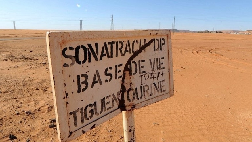 A road sign near a compound belonging to Algeria's Sonatrach oil company in the deep south desert on January 19, 2013. Chekib Khelil, Algeria's ex-energy minister and a once powerful figure in political and diplomatic circles, is now the target of an international arrest warrant for alleged corruption.