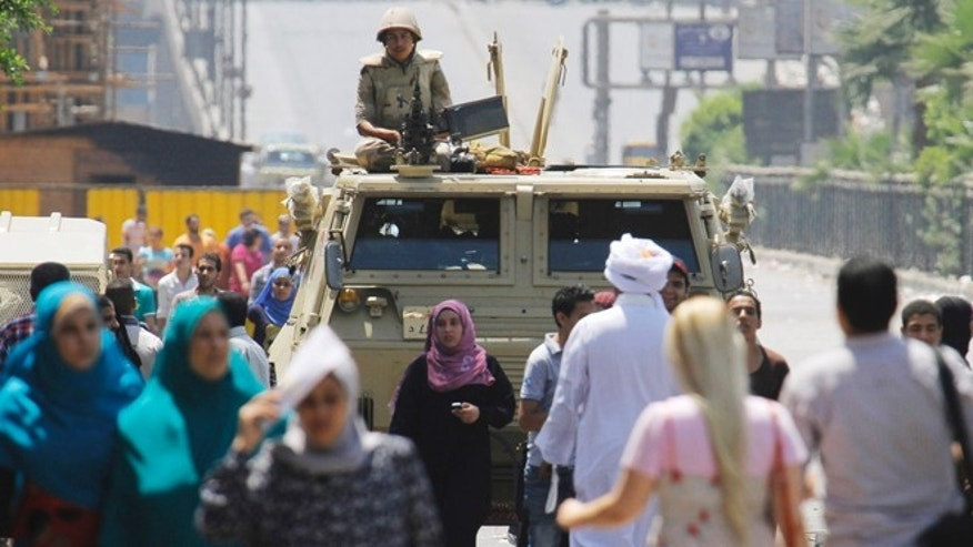 Aug. 12, 2013: An army soldier stands alert over an armored vehicle near Nahda Square, where supporters of Egypt's ousted President Mohammed Morsi have installed their camp near Cairo University in Giza, southwestern Cairo, Egypt.