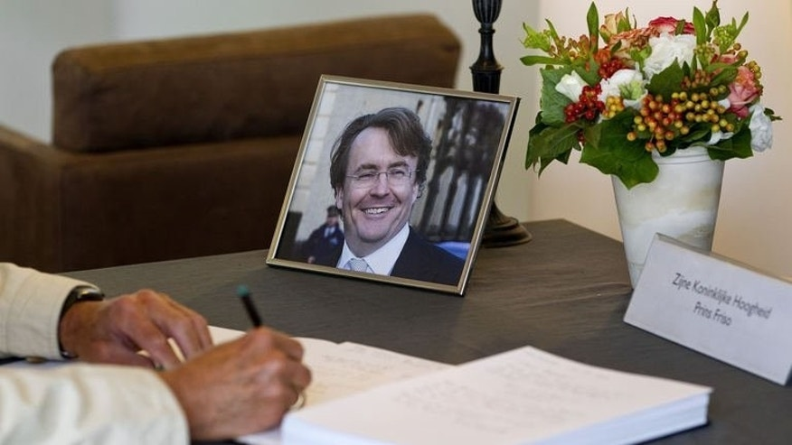 A man signs the condolence book for Prince Johan Friso in the town hall of Baarn on August 13, 2013. Dutch Prince Friso is to be buried near his mother's castle on Friday, days after he died from injuries sustained in a 2012 skiing accident, the palace said.