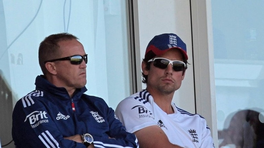 England coach Andy Flower (L) and captain Alastair Cook watch play from the stands on the first day of the fourth Ashes cricket Test match between England and Australia at the Riverside stadium in Chester-le-Street, north-east England, on August 9, 2013. Flower said on Tuesday that Cook deserved credit for his tactics after leading the side to an Ashes series win over Australia.