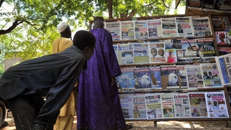 People look at newspapers at a newsstand on August 12, 2013, in Bamako the day after the presidential election run-off. France on Tuesday welcomed the election of a new president in Mali as vindication of its decision to send troops into its former colony.
