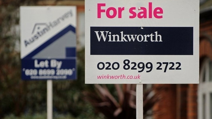 Estate agent's boards are displayed outside properties in London on December 30, 2010. Property prices across Britain are rising at their fastest pace since they hit a peak in 2006, a survey said on Tuesday.