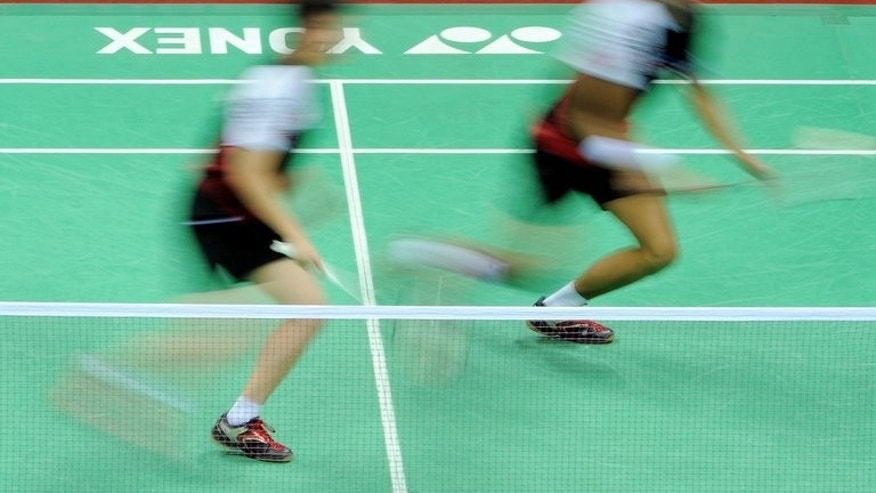 This file photo shows badminton players cometing at the Siri Fort Sports Complex in New Delhi, on April 28, 2012. Badminton takes a leap into the unknown on Wednesday, when a new franchise-based team event with innovative rules aimed at drawing bigger crowds opens in India.